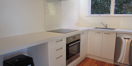 White Doors, White Benchtop, Timber Flooring