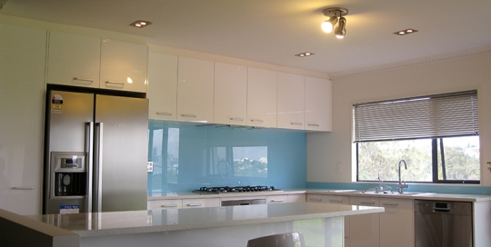 Light Benchtop, Gloss Doors, Blue Splashback