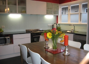 White units, black top, light splashback, glass doors