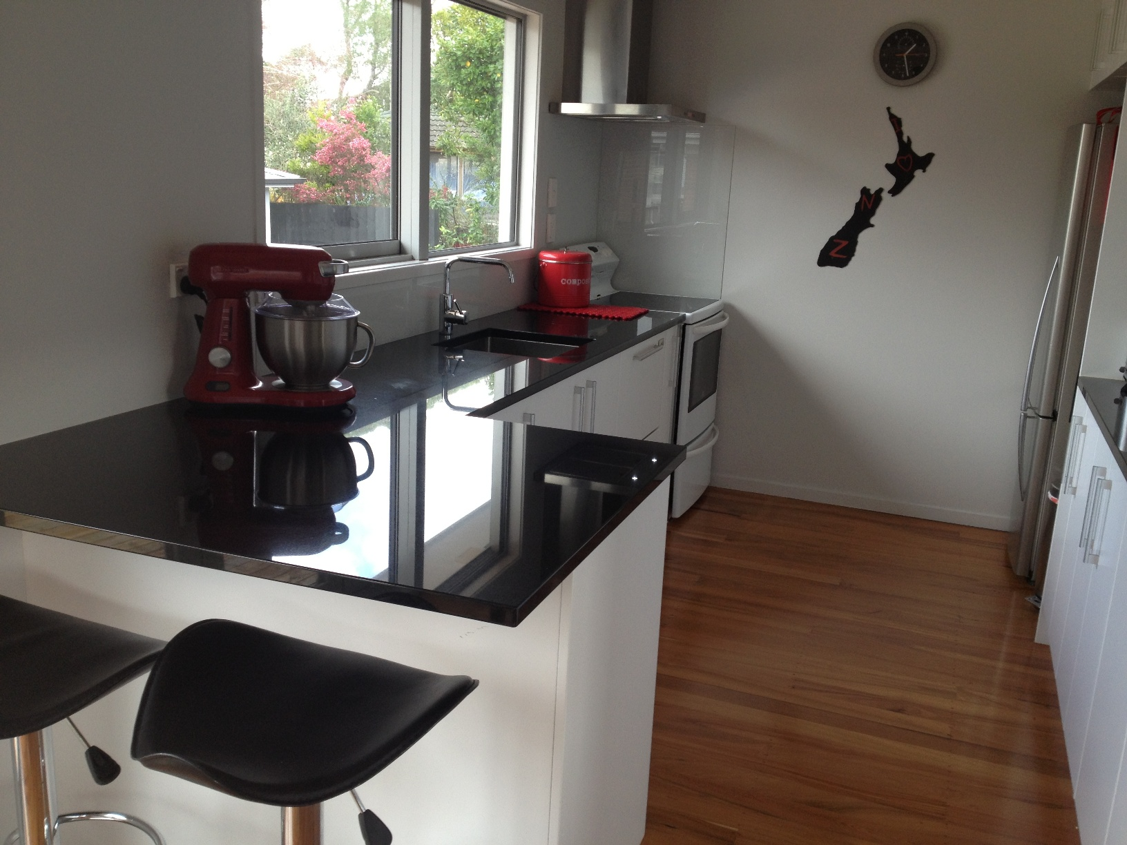 White doors with black benchtop