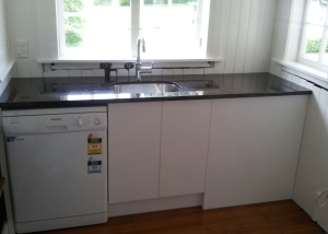 light units, dark granite benchtop, under-mounted sink
