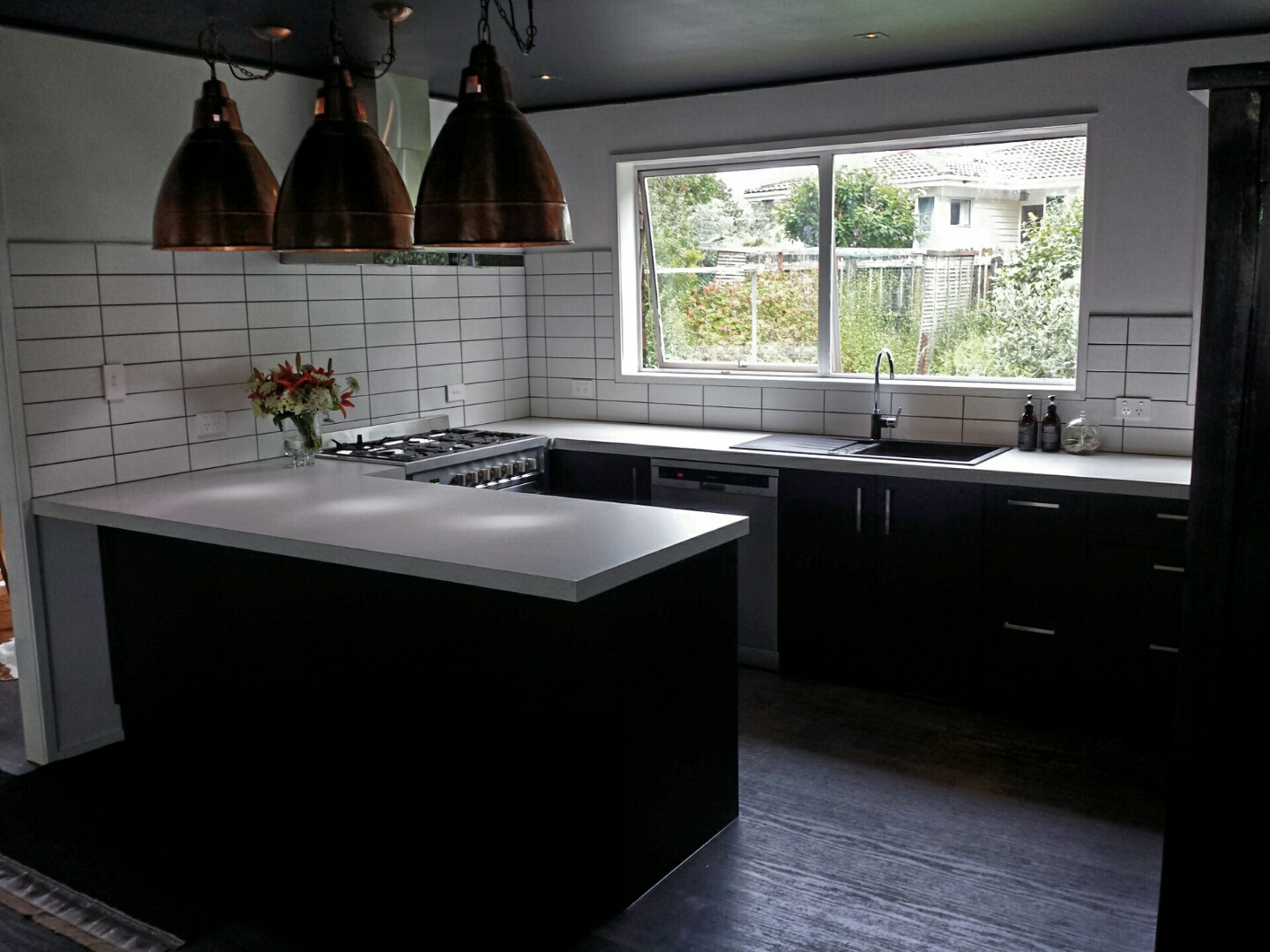 Black Kitchen With White Bench Top