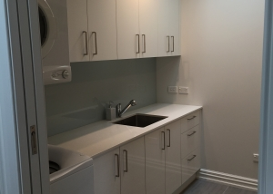 Sage Acrygloss White laundry with 20mm engienreed stone benchtop
